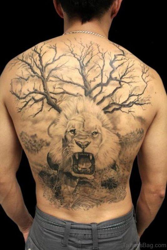 Tree And Lion Tattoo