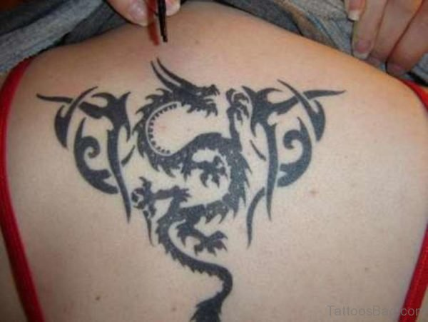 Tribal Dragon Tattoo On Upper Back