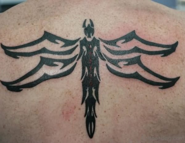 Tribal Dragonfly Tattoo On Upper Back