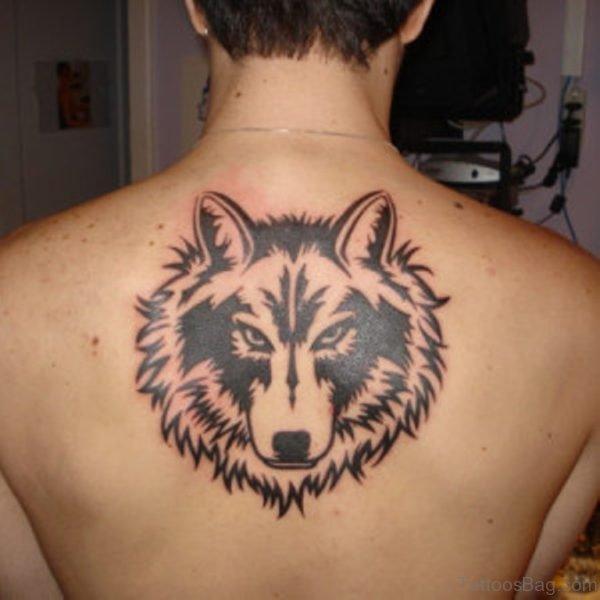 Tribal Wolf Tattoo On Upper Back