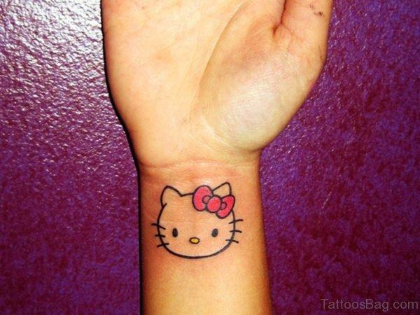 Typical  kitty Wrist Tattoo