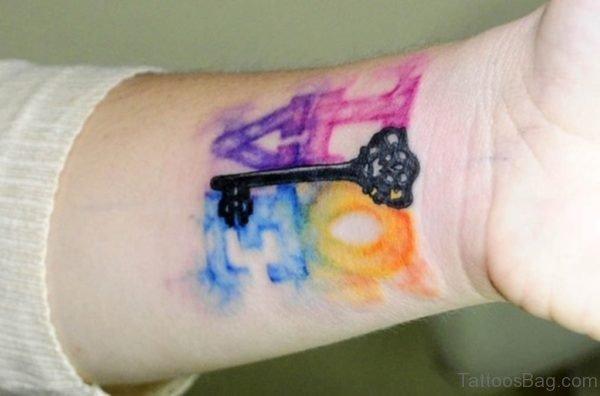 Watercolor Skeleton Key Tattoo On Wrist