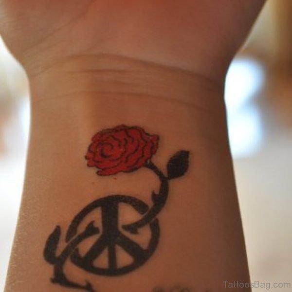 Wheel And Rose Tattoo On Wrist