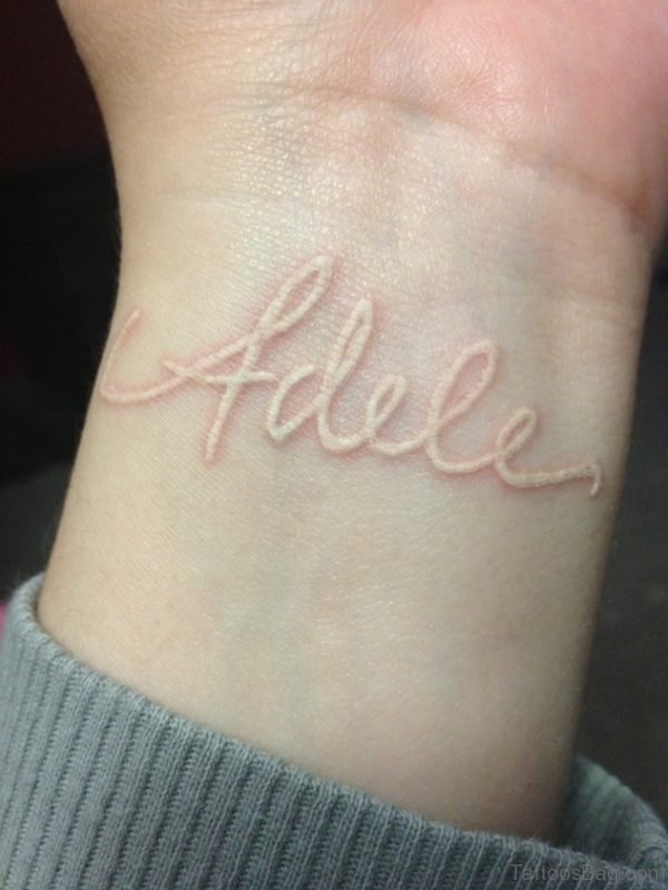 White Ink Name Tattoo