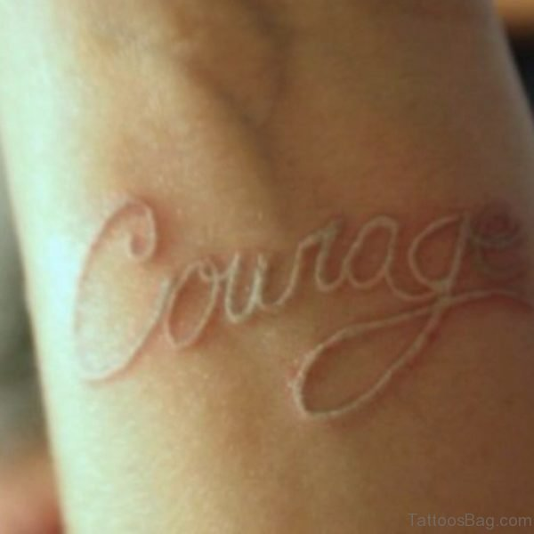 White Ink Word Tattoo On Wrist