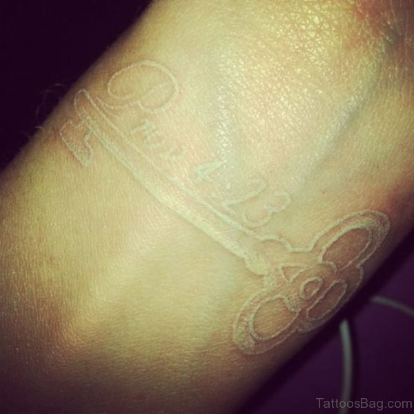 White Key Tattoo On Wrist