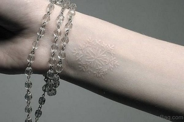 White Snowflake Tattoo On Wrist