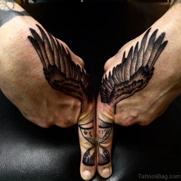 Wings Tattoo On Finger