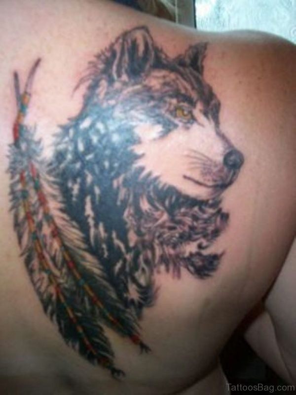 Wolf And Feather Tattoo