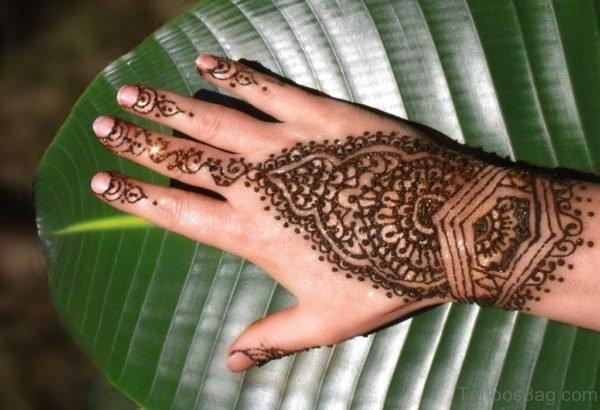 Wonderful Henna Flower Tattoo On Finger