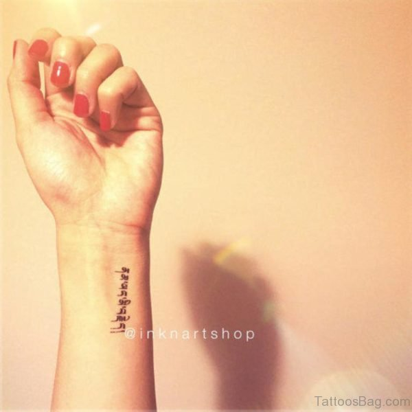 Word Tattoo On Wrist