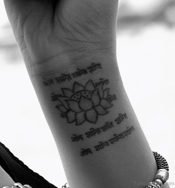 Wording And Lotus Tattoo