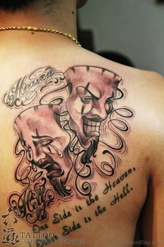 Wording And Mask Tattoo