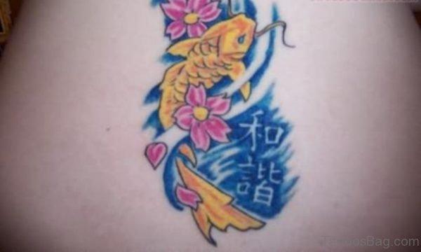 Yellow Fish Tattoo On Back