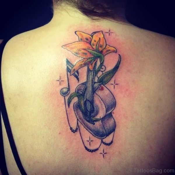 Yellow Flower And Music Note Tattoo