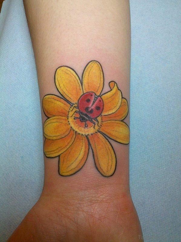 Yellow Flower Tattoo On Wrist