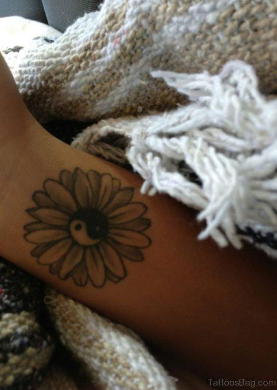 Yin Yang Daisy Tattoo On Wrist