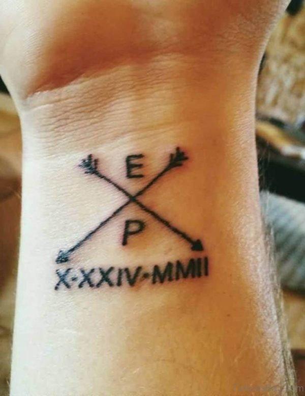Cross Arrow Tattoo