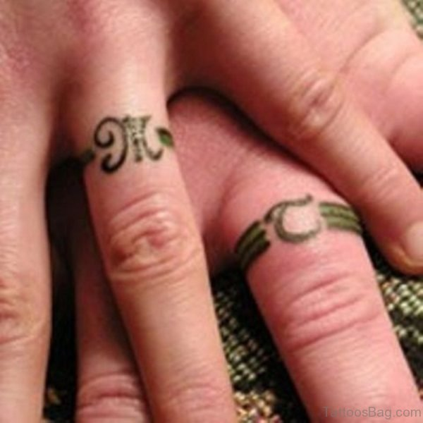 Green Ring Tattoo