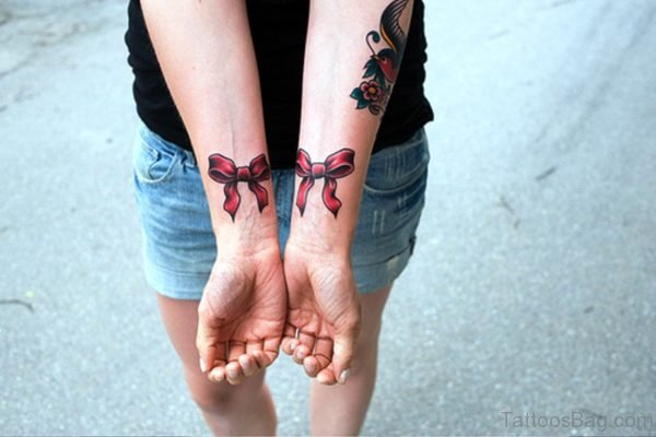 2 Red Bows Tattoos On Both Wrist
