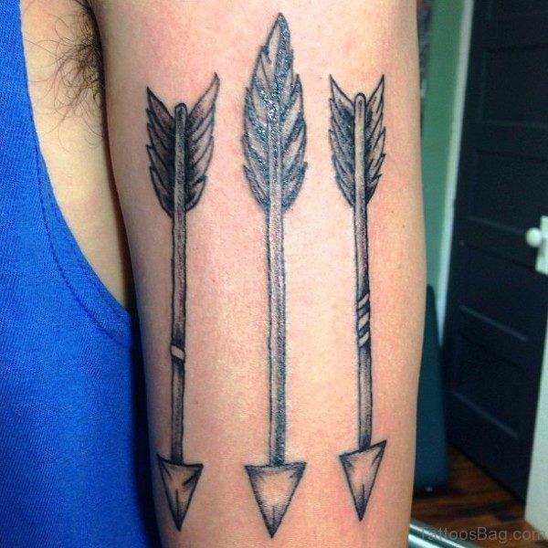 3 Black Ink Arrows Tattoo On Arm
