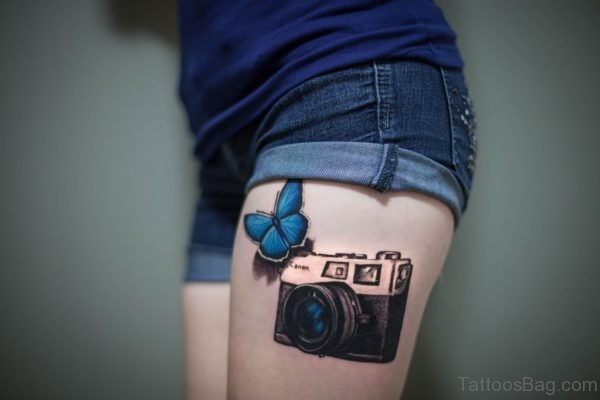 3D Butterfly And Canon Camera Tattoo On Thigh