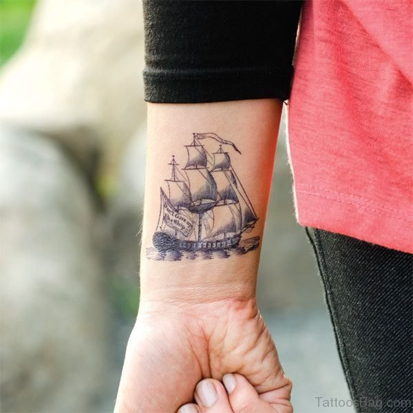 Adorable Boat Tattoo On Wrist