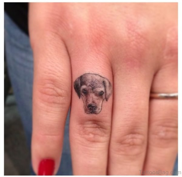 Adorable Dog Tattoo On Ring Finger