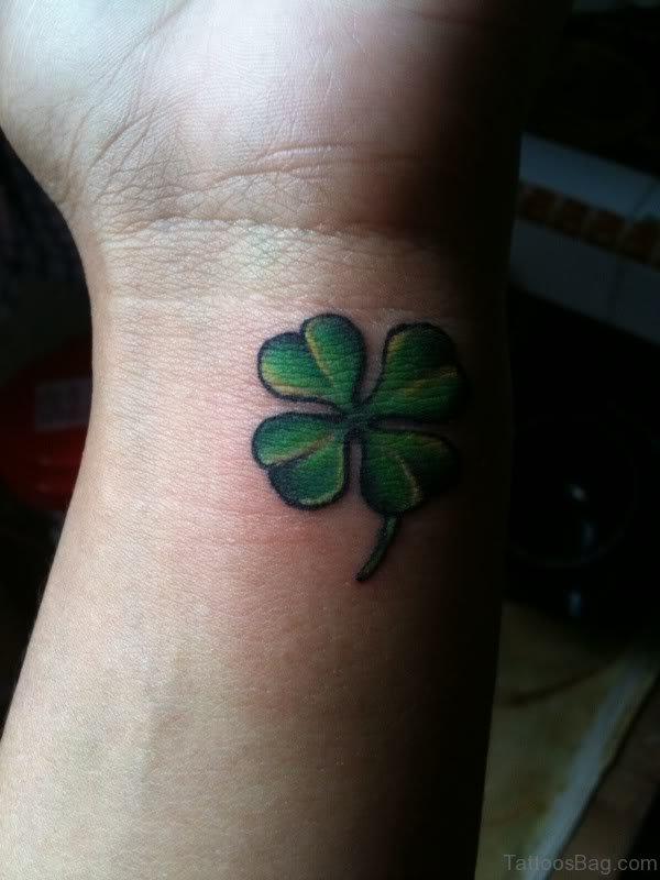 Adorable Four Leaf Tattoo On Wrist