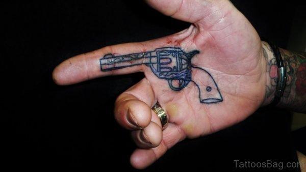 Adorable Gun Tattoo On Finger