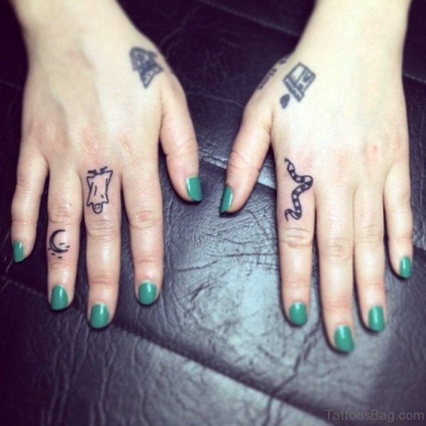 Adorable Moon Tattoo On Finger