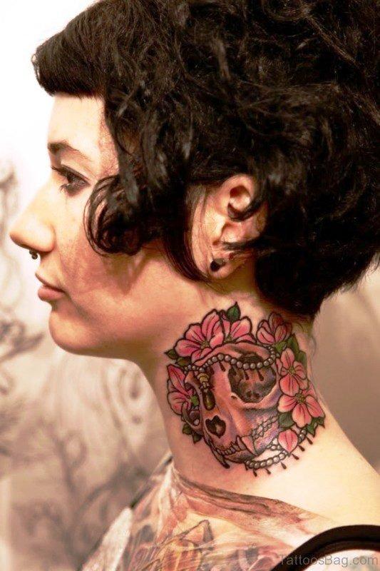 Adorable Neck Skull Tattoo Design