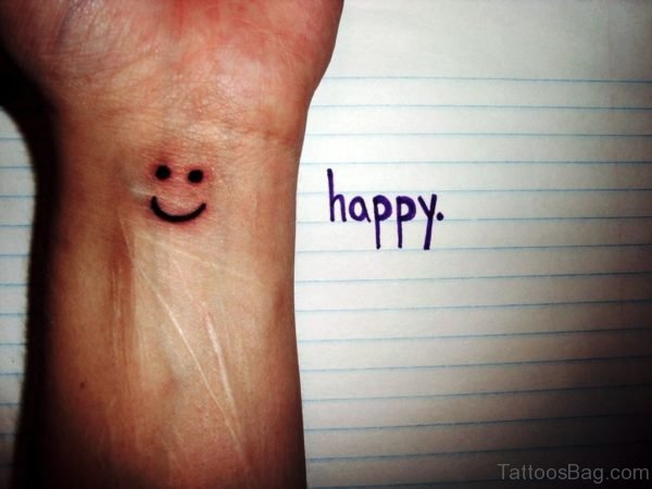 Adorable Smile Tattoo On Wrist