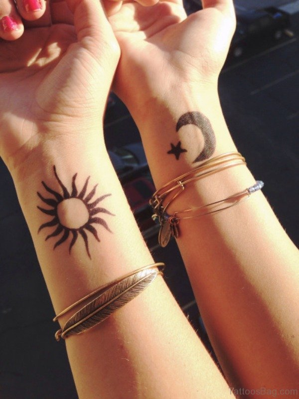 Adorable Sun Tattoo On Wrist