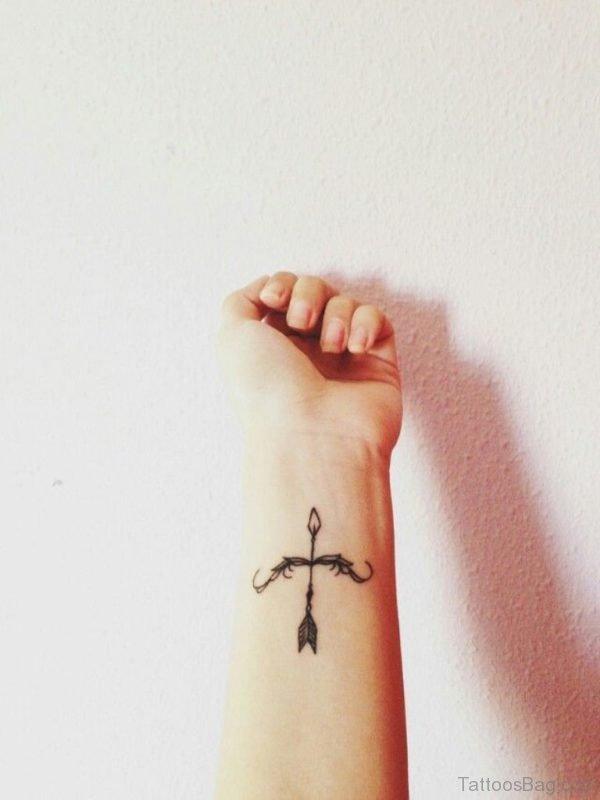 Adorable Tiny Bow And Arrow Tattoo On Wrist
