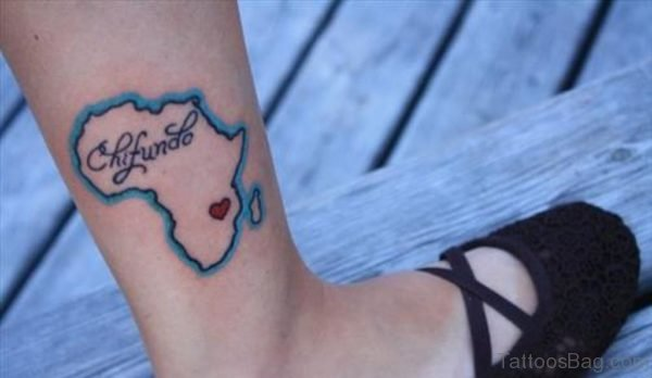 African Map With Tiny Red Heart Tattoo On Right Leg