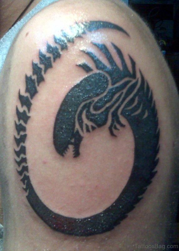 Alien Snake Tattoo Design On Shoulder