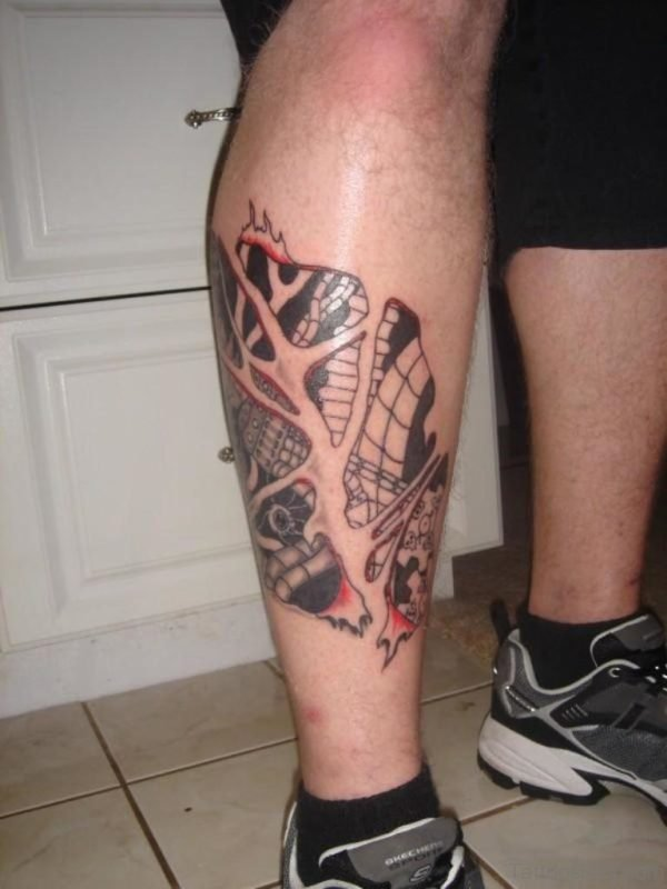 Amazing Biomechanical Tattoo On Leg Image
