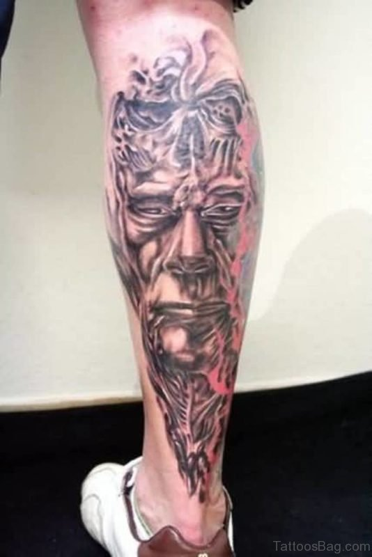 Amazing Face Mixed With Skull Tattoo On Leg