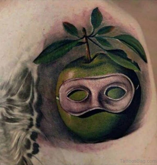 Amazing Green Apple Mask Tattoo On Shoulder