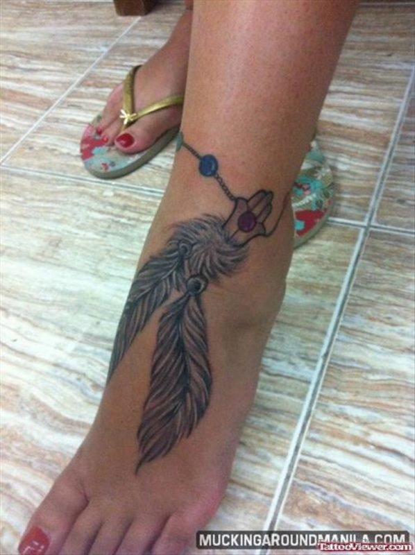 Amazing Grey Ink Feathers Tattoo
