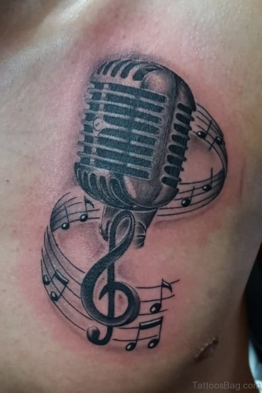 Amazing Grey Ink Mic And Music Notes Tattoo