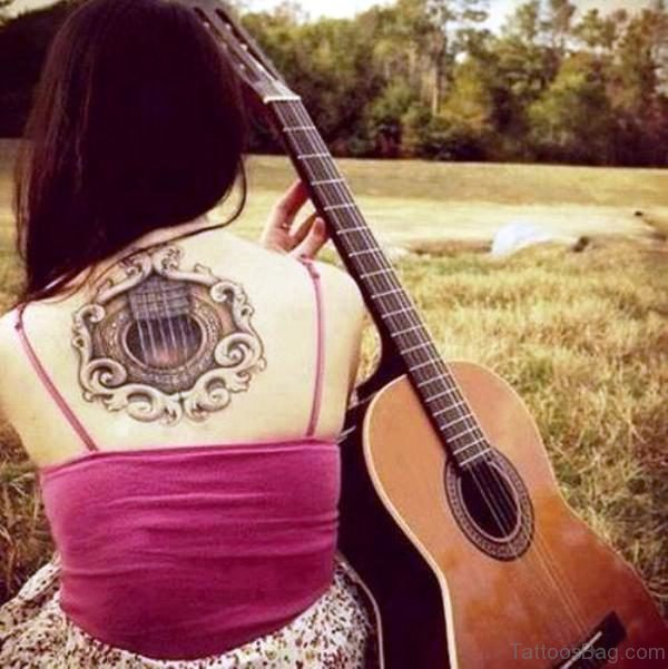 Amazing Guitar Tattoo On Back