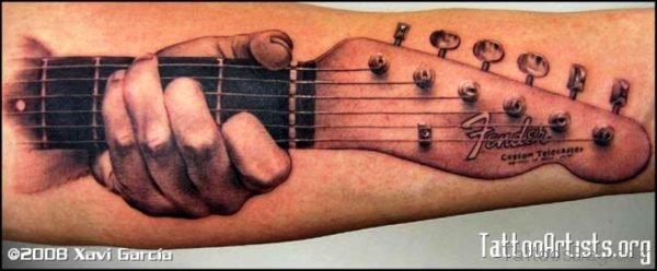 Amazing Hand Holding Guitar Tattoo