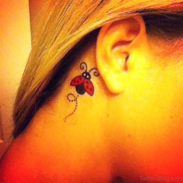 Amazing Ladybug Tattoo Behind Ear