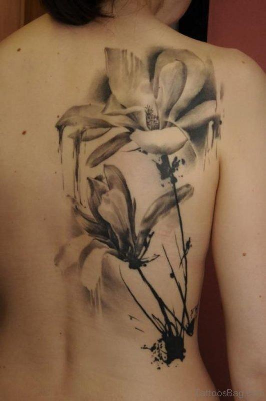 Amazing Magnolia Tattoo On Girl Right Back