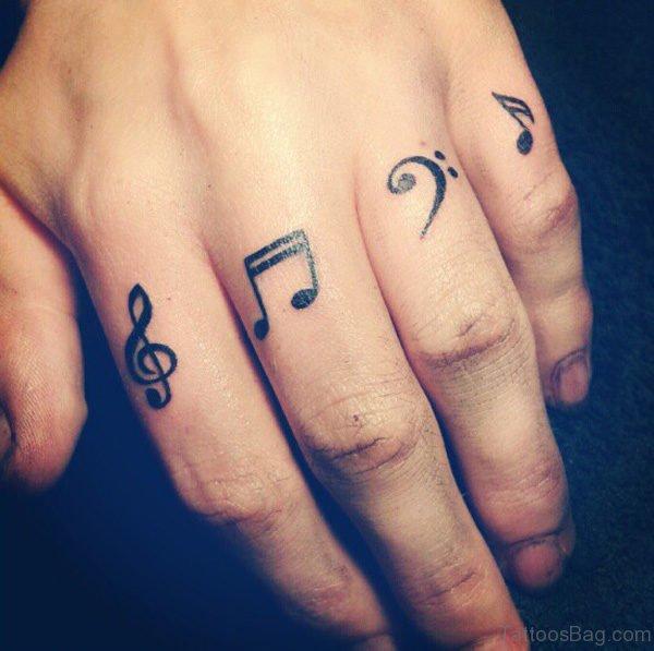 Amazing Music Symbol Tattoo On Fingers