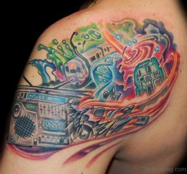 Amazing Music Tattoo On Shoulder Tattoo