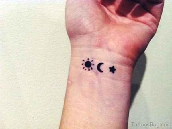 Amazing Sun Star Tattoo On Wrist