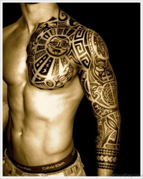 Amazing Tribal Design Tattoo On Left Full Sleeve And Chest